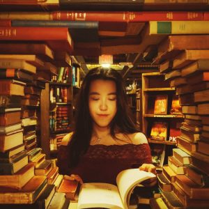 woman looking at types of books